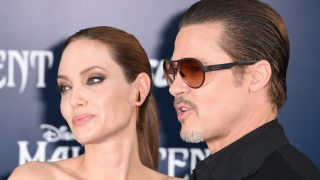 """Angelina Jolie and Brad Pitt arrive for the world premiere of Disney's """"Maleficent,"""" May 28, 2014, at El Capitan Theatre in Hollywood, California. AFP PHOTO / ROBYN BECK"""