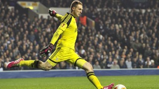 (FILES) A file picture taken on March 13, 2014 shows Benfica's Slovenian goalkeeper Jan Oblak kicking the ball during the UEFA Europa League round of 16 first leg football match between Tottenham Hotspur and Benfica at White Hart Lane in north London. Slovenian goalkeeper Jan Oblack has joined Atletico Madrid on a six-year deal, the club announced on July 16, 2014.  AFP PHOTO / GLYN KIRK
