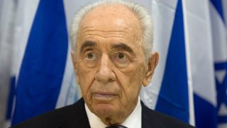 "Israeli President Shimon Peres looks on before talking to journalists during a visit in the southern Israeli town of Sderot, on July 6, 2014 following the recent Palestinian rocket attacks on the city. Peres, who will retire at the end of July, said ""I'm retiring from the post of president but I am not retiring for the battle for peace.""    AFP PHOTO/MENAHEM KAHANA"