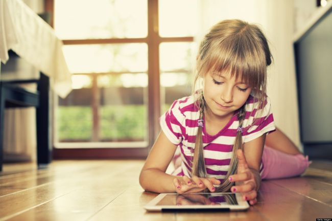 Little girl and a tablet