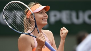 Russia's Maria Sharapova celebrates her victory over Spain's Garbine Muguruza at the end of their French tennis Open quarter final match at the Roland Garros stadium in Paris on June 3, 2014. AFP PHOTO / PASCAL GUYOT
