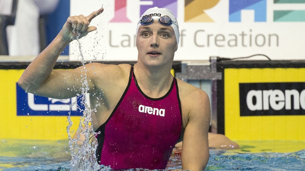 Hungary's Katinka Hosszu reacts after winning the finals of the women's 100m medley swimming event of the 18th European Short Course Championships in the Israeli coastal city of Netanya on December 4, 2015.  / AFP / JACK GUEZ
