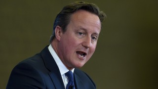 British Prime Minister David Cameron delivers a speech at Ninestiles Academy in Birmingham, central England, on July 20, 2015. Conspiracy theories of a powerful Jewish cabal or a Western plan to destroy Islam must be challenged in efforts to counter radicalisation, Cameron said.    AFP PHOTO / POOL / PAUL ELLIS