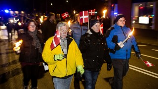 """Anti-Islam protesters, PEGIDA Denmark, attend a protest rally in Esbjerg on January 19, 2015. Pegida stands for """"Patriotic Europeans Against the Islamisation of the Occident"""".   AFP PHOTO / SCANPIX DENMARK / OLE JOERN  / DENMARK O"""