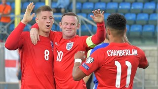 England's midfielder Ross Barkley (L) celebrates with England's forward Wayne Rooney (C) and England's forward Alex Oxlade Chamberlain after scoring during the EURO 2016 qualifying football match San Marino vs England at the San Marino stadium in Serravalle on September 5, 2015.  AFP PHOTO / VINCENZO PINTO