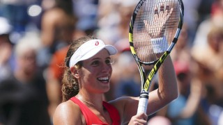 Johanna Konta of the United Kingdom celebrates after she defeated Andrea Petkovic of Germany during their 2015 US Open Women's Singles round 3 match at the USTA Billie Jean King National Tennis Center on September 5, 2015 in New York. AFP PHOTO/KENA BETANCUR
