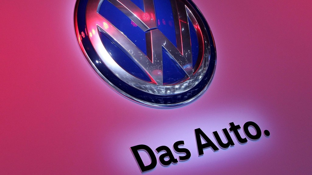 The logo of German car maker Volkswagen is pictured at the company's booth at the 66th IAA auto show in Frankfurt am Main, western Germany, on September 22, 2015. German auto giant Volkswagen revealed that 11 million of its diesel cars worldwide are equipped with devices that can cheat pollution tests, a dramatic escalation of the scandal that has wiped a third off the company's market value and now threatens to topple its chief executive.      AFP PHOTO / DANIEL ROLAND
