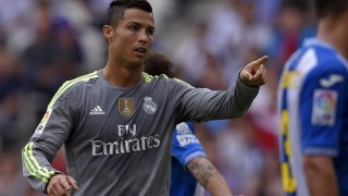 Real Madrid's Portuguese forward Cristiano Ronaldo reacts after scoring during the Spanish league football match RCD Espanyol vs Real Madrid CF at the Power8 stadium in Cornella de Llobregat on September 12, 2015. AFP PHOTO/ LLUIS GENE