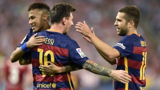 Barcelona's Argentinian forward Lionel Messi (C) celebrates with Barcelona's Brazilian forward Neymar (L) and Barcelona's defender Jordi Alba after scoring during the Spanish league football match Club Atletico de Madrid vs FC Barcelona at the Vicente Calderon stadium in Madrid on September 12, 2015.   AFP PHOTO/ GERARD JULIEN