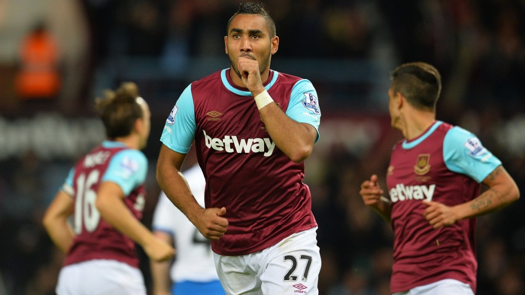 West Ham United's French midfielder Dimitri Payet celebrates scoring his second goal during the English Premier League football match between West Ham United and Newcastle United at The Boleyn Ground in Upton Park, East London on September 14, 2015.   AFP PHOTO / GLYN KIRK