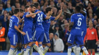 Chelsea's Brazilian-born Spanish striker Diego Costa (4L) celebrates with team mates after scoring the team's third goal during the UEFA Champions League, group G, football match between Chelsea and Maccabi Tel Aviv at Stamford Bridge in London on September 16, 2015.   AFP PHOTO / GLYN KIRK