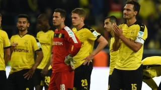 Dortmund´s players react after the German first division Bundesliga football match Borussia Dortmund v SV Darmstadt 98, in Dortmund, western Germany, on September 27, 2015. The match ended with a 2-2 draw. AFP PHOTO / PATRIK STOLLARZ  RESTRICTIONS: DURING MATCH TIME: DFL RULES TO LIMIT THE ONLINE USAGE TO 15 PICTURES PER MATCH AND FORBID IMAGE SEQUENCES TO SIMULATE VIDEO.  == RESTRICTED TO EDITORIAL USE == FOR FURTHER QUERIES PLEASE CONTACT DFL DIRECTLY AT + 49 69 650050.