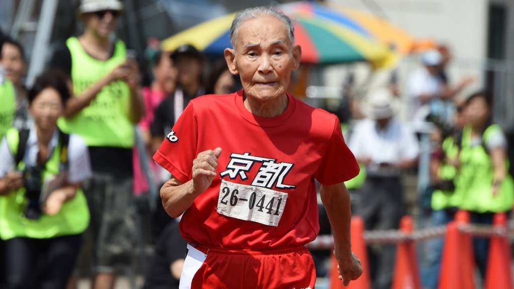 Hidekichi Miyazaki, 105, runs with other competitors over eighty years of age during a 100-metre-dash in the Kyoto Masters Autumn Competiton in Kyoto, western Japan, on September 23, 2015. Miyazaki was authorised as the oldest sprinter who competed in a 100-metre-dash by the Guinness World Records.      AFP PHOTO / Toru YAMANAKA