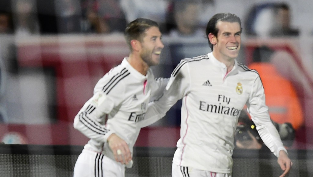 Real Madrid's Welsh forward Gareth Bale (R) celebrates with defender Sergio Ramos after scoring a goal against San Lorenzo during their FIFA Club World Cup final football match at the Marrakesh stadium in the Moroccan city of Marrakesh on December 20, 2014. AFP PHOTO / JAVIER SORIANO
