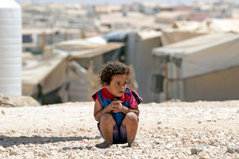 A young Syrian refugee looks on at the UN-run Zaatari camp, north east of the Jordanian capital Amman, on September 19, 2015. UN Humanitarian Chief Stephen O'Brien visited the Zaatari camp for talks with Jordanian officials on the refugee crisis. AFP PHOTO / KHALIL MAZRAAWI