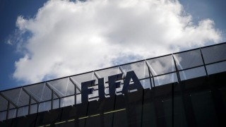 A cloud is seen above the headquarters of the football's world body FIFA on July 20, 2015 in Zurich. FIFA leaders met on July 20 to decide a date for an election to replace president Sepp Blatter and reform steps as football's world body confronts its biggest corruption crisis.  AFP PHOTO / FABRICE COFFRINI