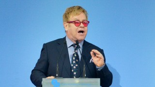 Sir Elton John delivers a speech about tolerance and equal rights for all during 12th Yalta European Strategy forum (YES) in Kiev on September 12, 2015. AFP PHOTO / GENYA SAVILOV