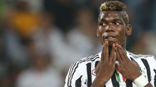 Juventus' midfielder Paul Pogba from France reacts during the Italian Serie A  football match between Juventus and Chievo on September 12, 2015 at the Juventus Stadium in Turin.  AFP PHOTO / MARCO BERTORELLO
