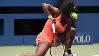 Serena Williams of the US reacts while playing against Roberta Vinci of Italy during their 2015 US Open Women's singles semifinals match at the USTA Billie Jean King National Tennis Center in New York on September 11, 2015. Vinci won 2-6, 6-4, 6-4. AFP PHOTO/JEWEL SAMAD