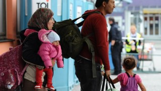 A refugee family from Syria heads to their registration after arriving in a chartered train from Vienna, Austria, at the railway station in Freilassing, Germany, 20 September 2015, before continuing their journey to Hanau, Germany. Photo:Andreas Gebert/dpa