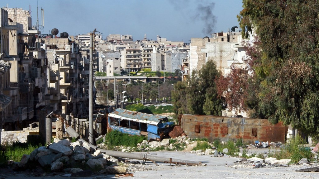 ALEPPO, SYRIA - MARCH 17: A wall built with the wreckage of buses is seen in the Bustan al-Qasr neighborhood of Aleppo, Syria on March 17, 2015. Opponents of the Syrian regime built a wall made of the wreckage of buses to protect civilians from the snipers of Syrian regime forces. Ahmed Muhammed Ali / Anadolu Agency