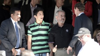MADRID, SPAIN - SEPTEMBER 19: Osama Abdul Mohsen (2nd R), the Syrian refugee who had tripped over by a Hungarian journalist and his sons Mohammad (2nd L) and Zaid (not seen)  attend La Liga football match  between Real Madrid CF vs Granada FC as the guests of Real Madrid CF at the Santiago Bernabeu stadium in Madrid on September 19, 2015 Burak Akbulut / Anadolu Agency
