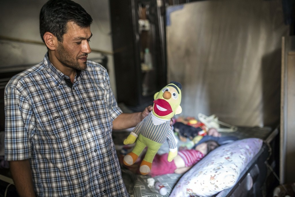 Abdullah Kurdi, father of three-year-old Aylan Kurdi (also know as Aylan Shenu) who drowned off Turkey, Abdullah Kurdi stands in Aylan's room on September 6, 2015 in Kobane. Aylan Kurdi was buried with his four-year-old brother and mother on September 4 in Kobane. They had been living in Damascus but were forced to flee the war's instability which has left more than 240,000 people dead, more than four million have sought refuge in nearby countries, and millions more have been internally displaced. AFP PHOTO / YASIN AKGUL