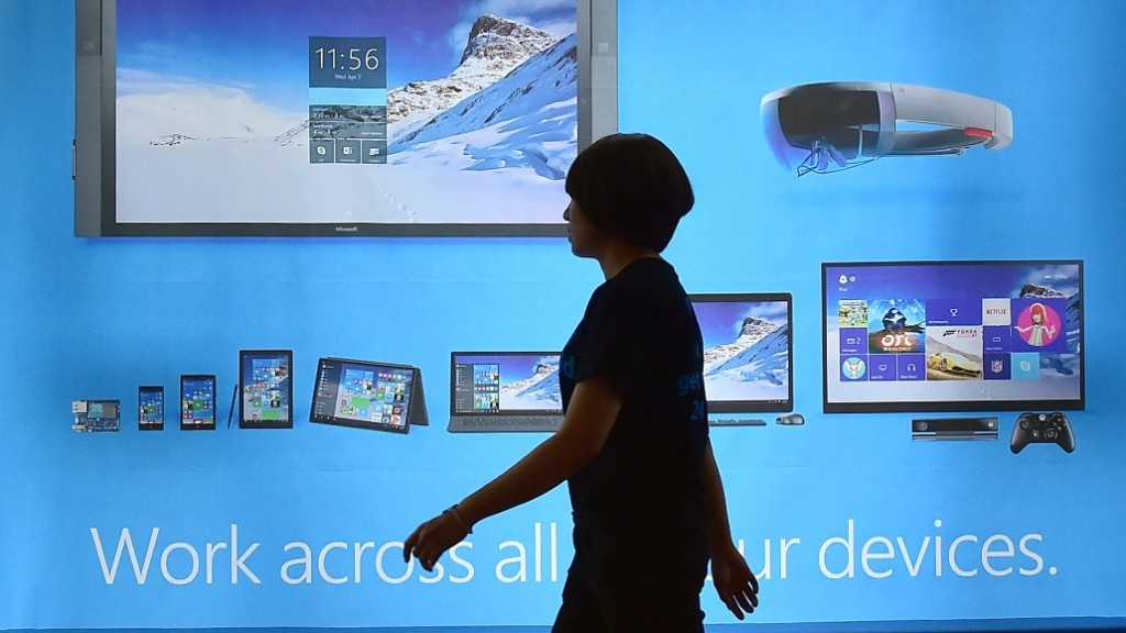 A woman walks past a billboard for Windows 10, the latest operating system from US software giant Microsoft, during a launch event in Seoul on July 29, 2015. Microsoft is aiming to build lasting relationships with the operating system Windows 10 seen as critical to reviving the fortunes of the once-dominant tech giant. AFP PHOTO / JUNG YEON-JE