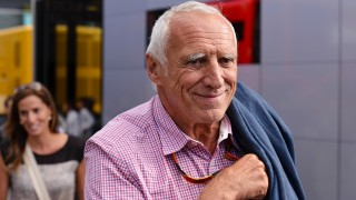The chairman of Red Bull, Austrian Dietrich Mateschitz, smiles as he leaves the Red Bull Energy Station in the paddock at the Red Bull Ring race track in Spielberg, Austria, 21 June 2014. The 2014 Formula One Grand Prix of Austria will take place on 22 June. Photo: David Ebener/dpa - NO WIRE SERVICE -