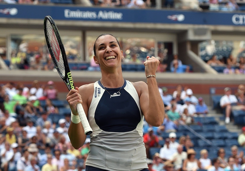 Flavia Pennetta of Italy celebrates match point against Petra Kvitova of the Czech Republic during their 2015 US Open  Women's Singles - Quarterfinals at the USTA Billie Jean King National Tennis Center September 9, 2015  in New York. Pennetta  won 4-6, 6-4, 6-2.        AFP PHOTO /  TIMOTHY  A. CLARY