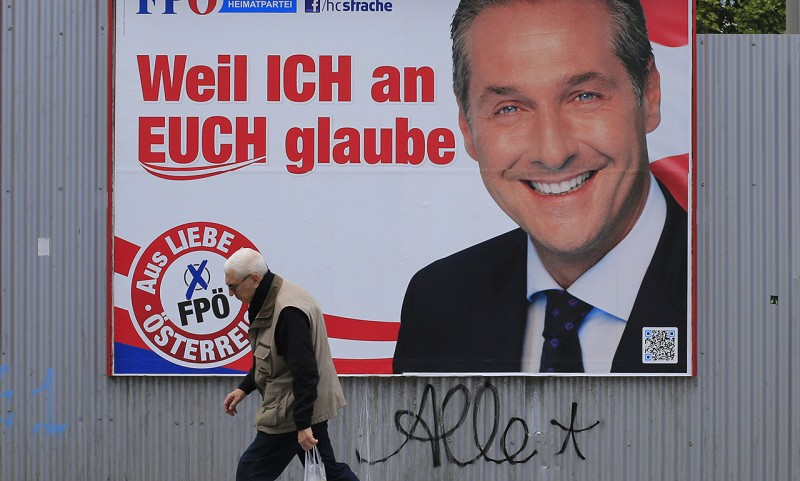 A man walks past the campaign billboard of Austria's FPO (Freedom Party of Austria) party candidate Heinz Christian Strache on September 19 2013, in Vienna, ahead of the legislative elections held on September 29, 2013.  AFP PHOTO / ALEXANDER KLEIN