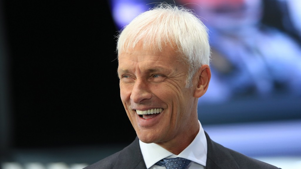FILE PHOTO: Matthias Mueller, chief executive officer of Porsche AG, reacts during a Bloomberg Television interview during previews to IAA Frankfurt Motor Show in Frankfurt, Germany, on Tuesday, Sept. 15, 2015. Volkswagen said 11 million vehicles were equipped with diesel engines at the center of a widening scandal over faked pollution controls that will cost the company at least 6.5 billion euros ($7.3 billion). Photographer: Krisztian Bocsi/Bloomberg via Getty Images