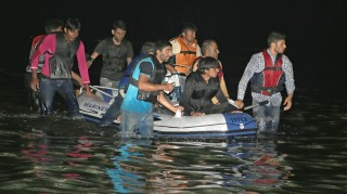 MUGLA, TURKEY - SEPTEMBER 5:  Turkish Coast Guard rescue 12 Pakistani migrants whose boat sank off Akyarlar Coast in Bodrum district of Mugla as they were trying to reach Greece's Kos island on September 5, 2015. Mustafa Ciftci / Anadolu Agency