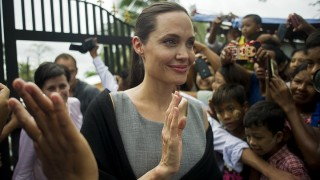 UN High Commissioner for Refugees (UNHCR) Goodwill Ambassador Angelina Jolie (C) leaves after meeting with women factory workers at a hostel in Hlaing Thar Yar Township in Yangon on August 1, 2015. Jolie flew into Myanmar for a humanitarian visit, becoming the latest in a growing list of celebrities who have travelled to the former junta-run nation. AFP PHOTO / Ye Aung THU