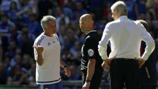 Chelsea's Portuguese manager Jose Mourinho (L) gestures as Arsenal's French manager Arsene Wenger looks on during the FA Community Shield football match between Arsenal and Chelsea at Wembley Stadium in north London on August 2, 2015. Arsenal won the game 1-0. AFP PHOTO / IAN KINGTON   -- NOT FOR MARKETING OR ADVERTISING USE / RESTRICTED TO EDITORIAL USE --