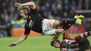 Manchester's defender Luke Shaw (L) is challenged by Eindhoven's Mexican defender Hector Moreno during the UEFA Champions League Group B football match between PSV Eindhoven and Manchester United at the Philips stadium in Eindhoven, the Netherlands, on September 15, 2015. AFP PHOTO / JOHN THYS