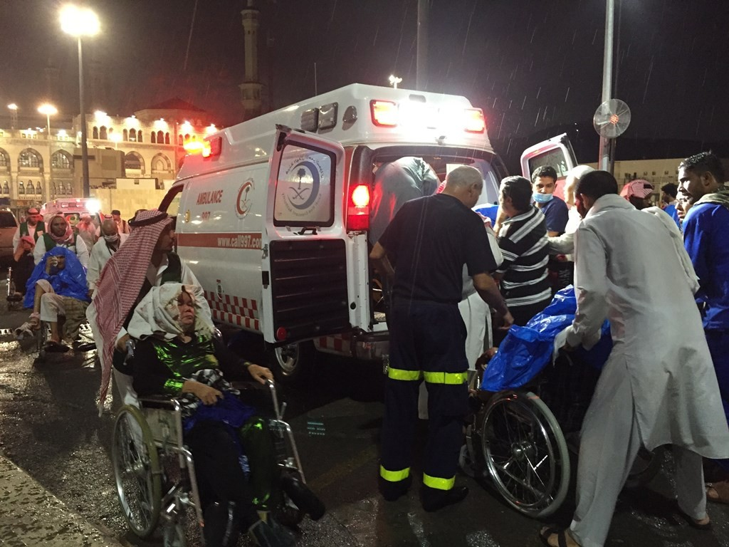 MECCA, SAUDI ARABIA - SEPTEMBER 11: Paramedics and officals hospitalize wounded people after a construction crane collapsed over the Muslim pilgrims around the Muslims' holy place Kaaba in Mecca, Saudi Arabia on September 11, 2015. Crane crash, believed collapsed by strong winds, killed at least 52 people and left many others wounded. Kaaba and surrounded area were under construction due to expansion reasons. Ozkan Bilgin / Anadolu Agency