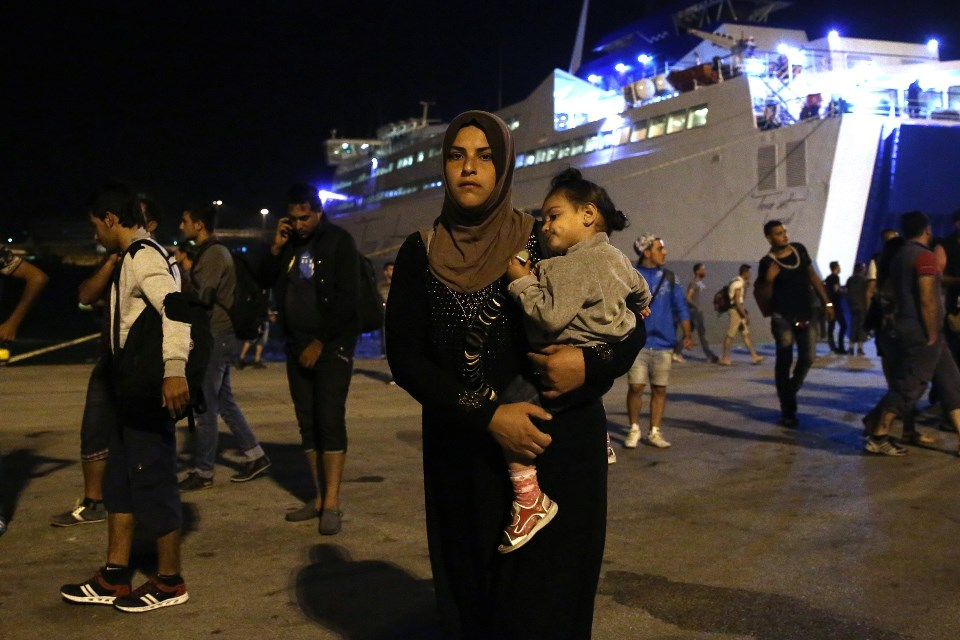 ATHENS, GREECE - SEPTEMBER 1: Migrants disembark from the passenger ship 'Tera Jet', following their trip from the island of Lesbos to the port of Piraeus, near Athens, Greece on September 1, 2015. Ayhan Mehmet / Anadolu Agency