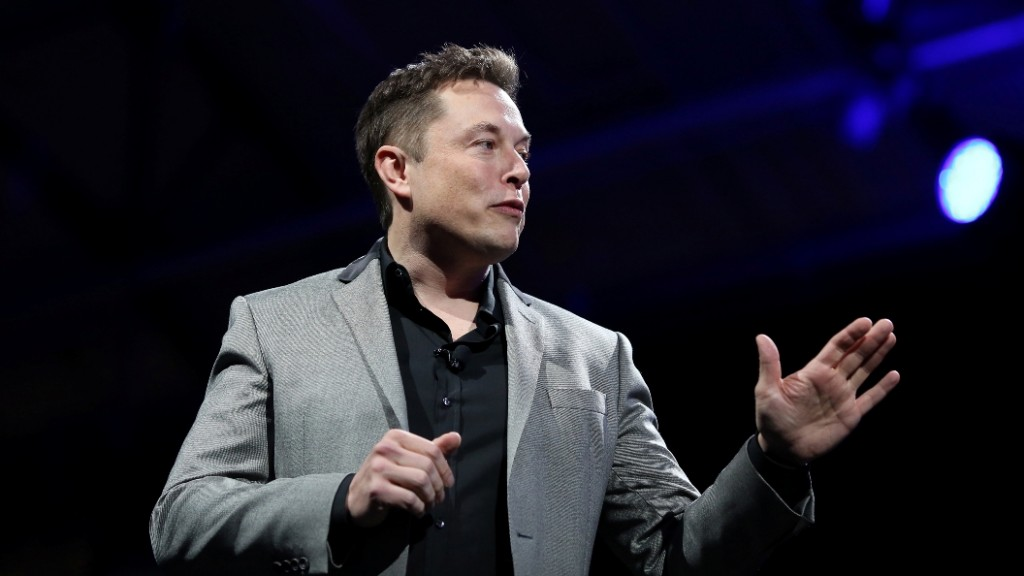 """Tesla Motors CEO Elon Musk unveils large utility scale home batteries at the Tesla Design Studio in Hawthorne, California, April 30, 2015.  Electric car pioneer Telsa Motors unveiled a """"home battery"""" Thursday which its founder Elon Musk said would help change the """"entire energy infrastructure of the world.""""      AFP PHOTO / David McNew"""