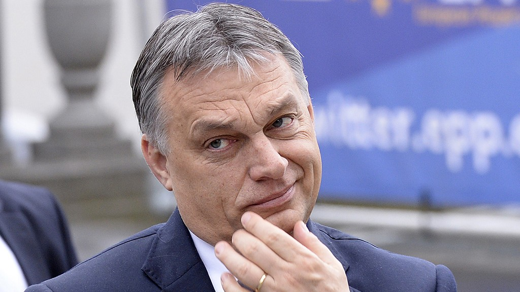 Hungarian Prime Minister Viktor Orban arrives for an European People's Party (EPP) meeting ahead of a European leaders summit in Brussels on March 19, 2015.  AFP PHOTO / THIERRY CHARLIER