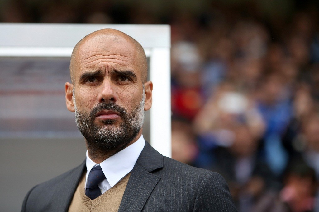 Munich's coach Pep Guardiola before the kick off in the German Bundesliga soccer match between SV Darmstadt 98 and FC Bayern Munich in Darmstadt, Germany, 19 September 2015. Photo: FREDRIKVONERICHSEN/dpa  (EMBARGO CONDITIONS - ATTENTION: Due to the accreditation guidelines, the DFL only permits the publication and utilisation of up to 15 pictures per match on the internet and in online media during the match.)