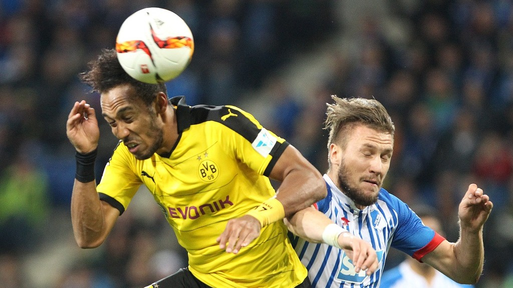 Hoffenheim's Bosnian defender Ermin Bicakcic (R) and Dortmund's Gabonese striker Pierre-Emerick Aubameyang vie for the ballduring the German first division Bundesliga football match TSG 1899 Hoffenheim vs Borussia Dortmund in Sinsheim, on September 23, 2015.    AFP PHOTO / DANIEL ROLAND  RESTRICTIONS: DURING MATCH TIME: DFL RULES TO LIMIT THE ONLINE USAGE TO 15 PICTURES PER MATCH AND FORBID IMAGE SEQUENCES TO SIMULATE VIDEO.  ==RESTRICTED TO EDITORIAL USE == FOR FURTHER QUERIES PLEASE  CONTACT THE  DFL DIRECTLY AT + 49 69 650050.
