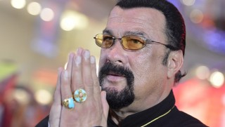 2693837 09/05/2015 American actor, film producer and scriptwriter, martial artist and musician Steven Seagal at Moscow's Alley of Glory near the VEGAS shopping mall. Ramil Sitdikov/RIA Novosti