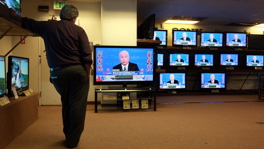 SAN FRANCISCO - OCTOBER 15:  A worker at Video Only watches the presidential debate as Republican candidate U.S. Sen. John McCain (R-AZ) speaks on a television October 15, 2008 in San Francisco, California. With 20 days to go until election day, Americans are tuning in to watch the final presidential debate.  (Photo by Justin Sullivan/Getty Images)