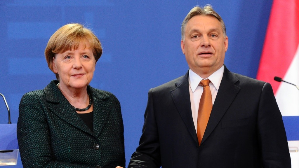 German Chancellor Angela Merkel (L) is welcomed by Hungarian Prime Minister Viktor Orban (R) in the parliament in Budapest on February 2, 2015 during Merkel's firts visit to Hungary in last five years. AFP PHOTO / ATTILA KISBENEDEK