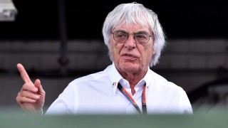 F1 supremo and the sport's chief executive Bernie Ecclestone walks in the paddock after the qualifying session at the Hungaroring circuit near Budapest on July 25, 2015, on the eve of the Hungarian Formula One Grand Prix AFP PHOTO / ANDREJ ISAKOVIC