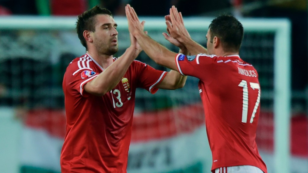 Hungary's Daniel Bode (L) celebrates scoring with his teammate Nemanja Nikolic during the Euro 2016 Group F qualifying football match between Hungary and Faroe Islands at the Groupama Arena in Budapest, Hungary on October 8, 2015. AFP PHOTO / ATTILA KISBENEDEK