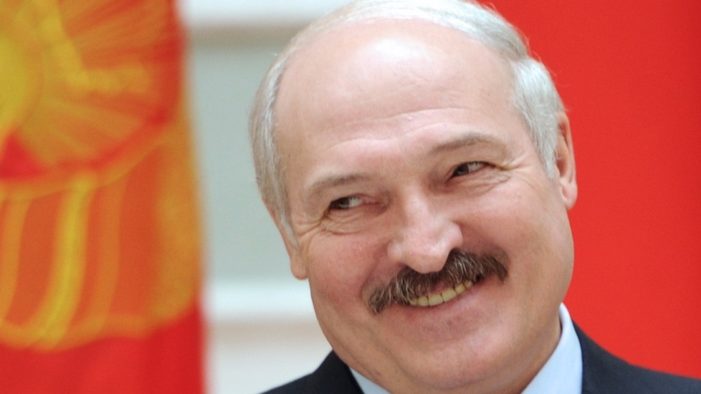 (FILES) A file picture taken on May 10, 2015 shows Belarus' President Alexander Lukashenko applauding during a signing ceremony with his Chinese counterpart Xi Jinping (not pictured) in Minsk. EU foreign ministers agreed on October 12 to suspend sanctions against Belarus due shortly for renewal after elections won by authoritarian President Alexander Lukashenko passed off without incident, France's european affairs minister said. AFP PHOTO / SERGEI GAPON