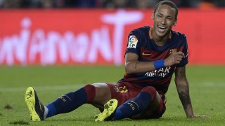 Barcelona's Brazilian forward Neymar da Silva Santos Junior smiles as he sits on the field during the Spanish league football match FC Barcelona vs Rayo Vallecano de Madrid at the Camp Nou stadium in Barcelona on October 17, 2015.   AFP PHOTO/ JOSEP LAGO