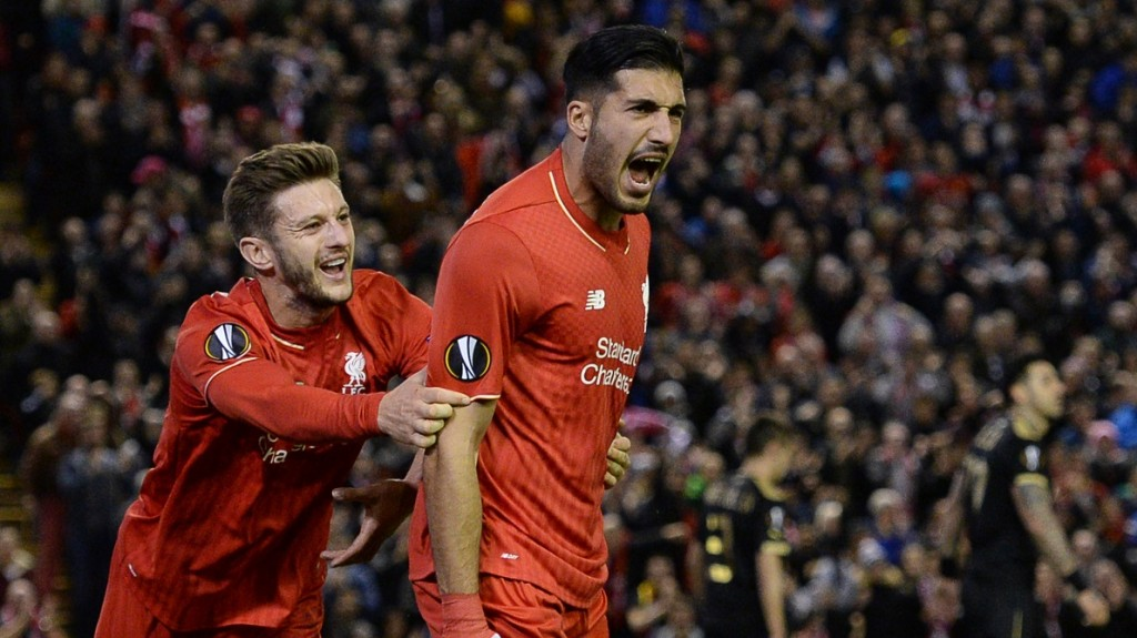 Liverpool's German midfielder Emre Can (R) celebrates after scoring his team's first goal during a UEFA Europa League group B football match between Liverpool FC and FC Rubin Kazan at Anfield in Liverpool, north west England, on October 22, 2015. AFP PHOTO / OLI SCARFF